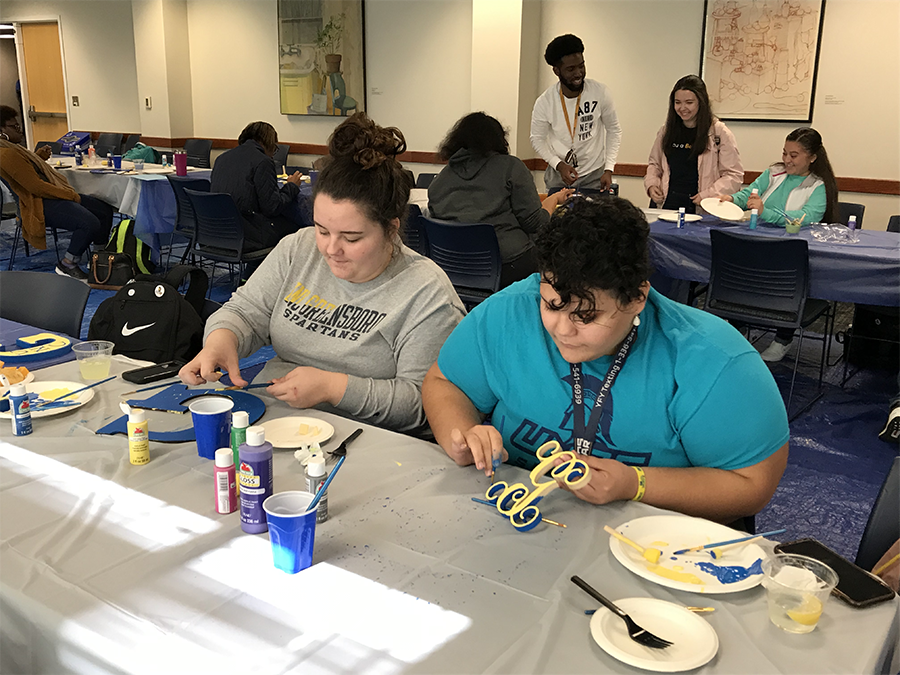 UNCG Students pictured an on-campus painting event