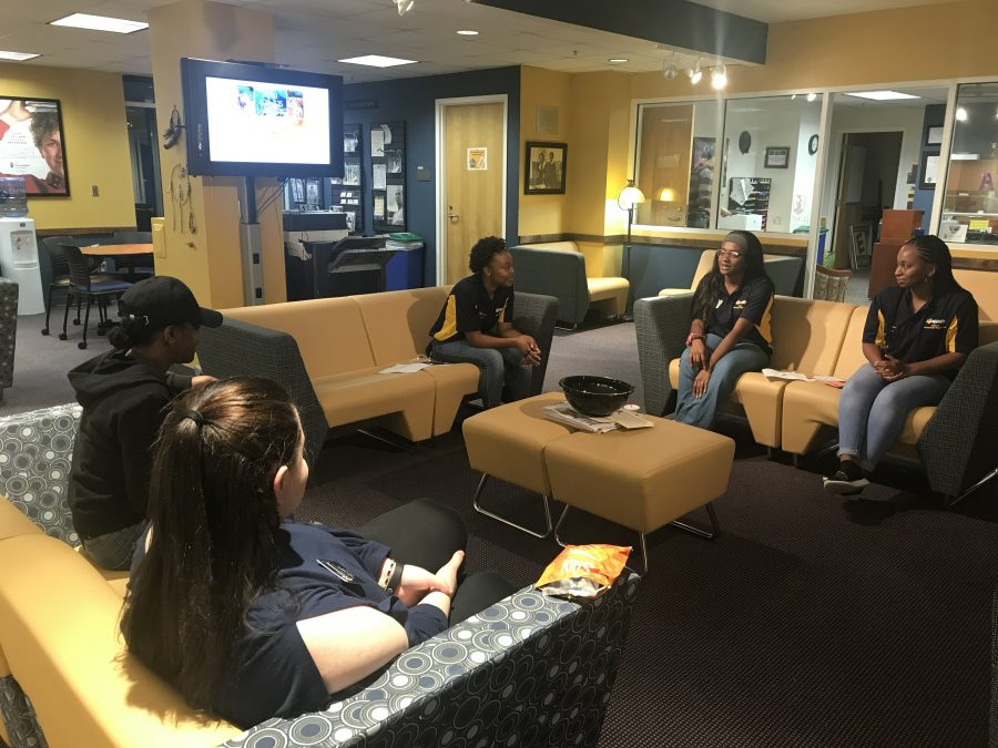 Student employees hanging out in the Office of Intercultural Engagement