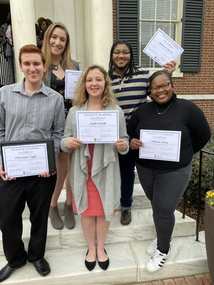 Student from HRL pose with Award for Academic Excellence
